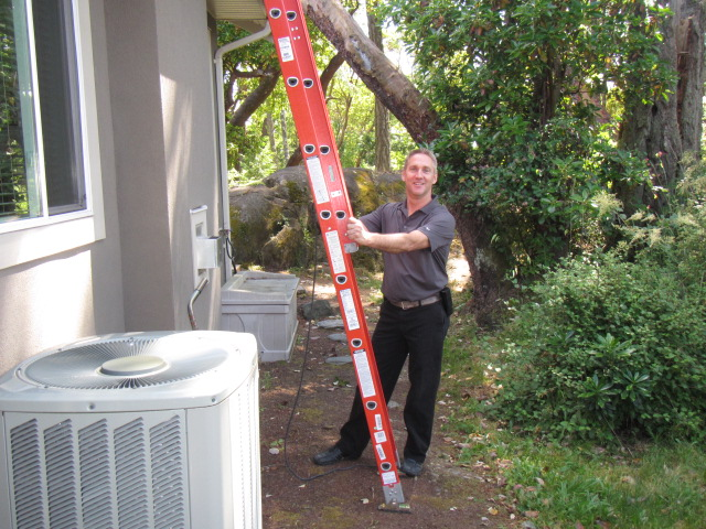 Garth standing by his ladder